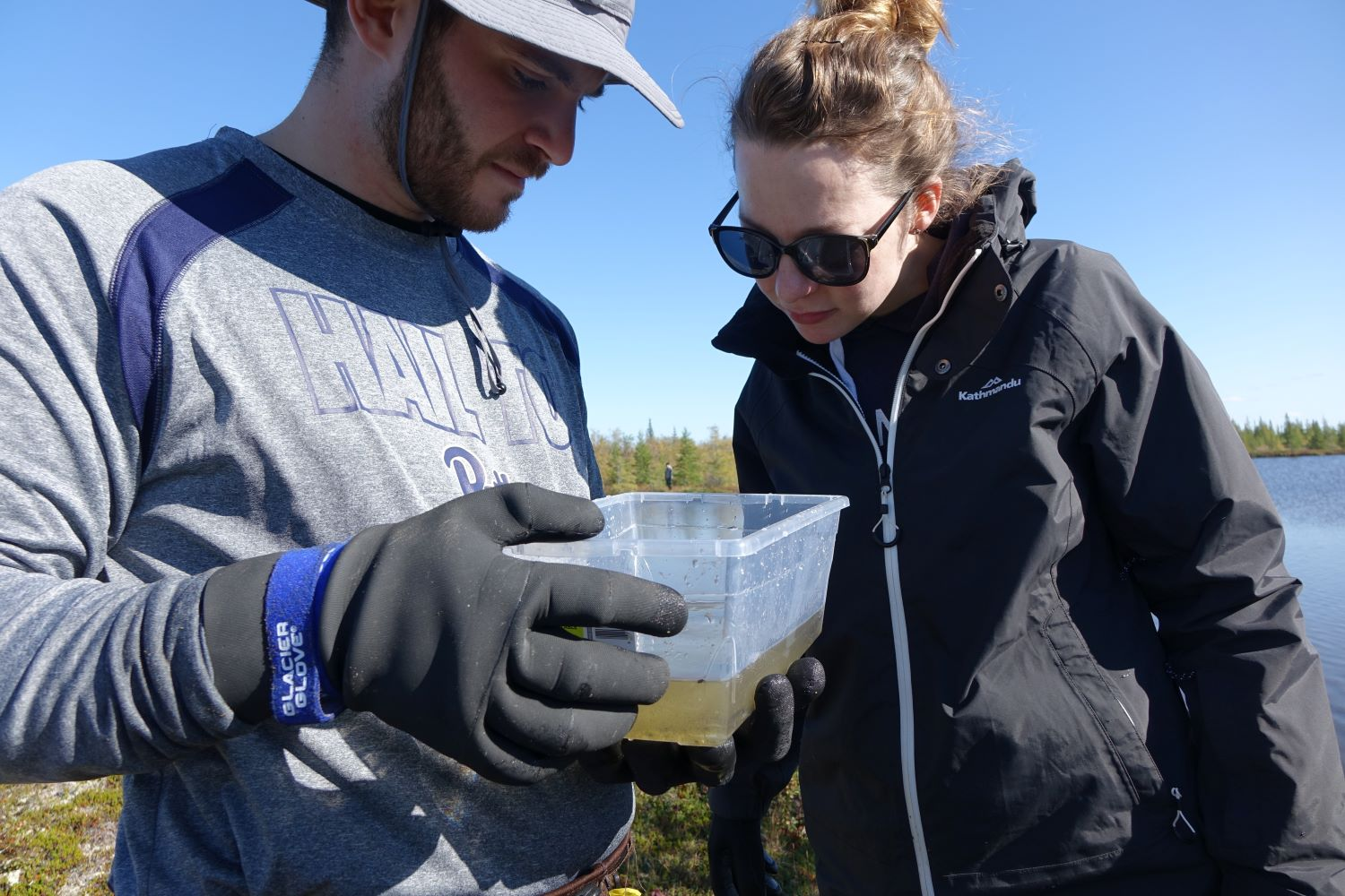 Two Alcoa employees observing the species they collected