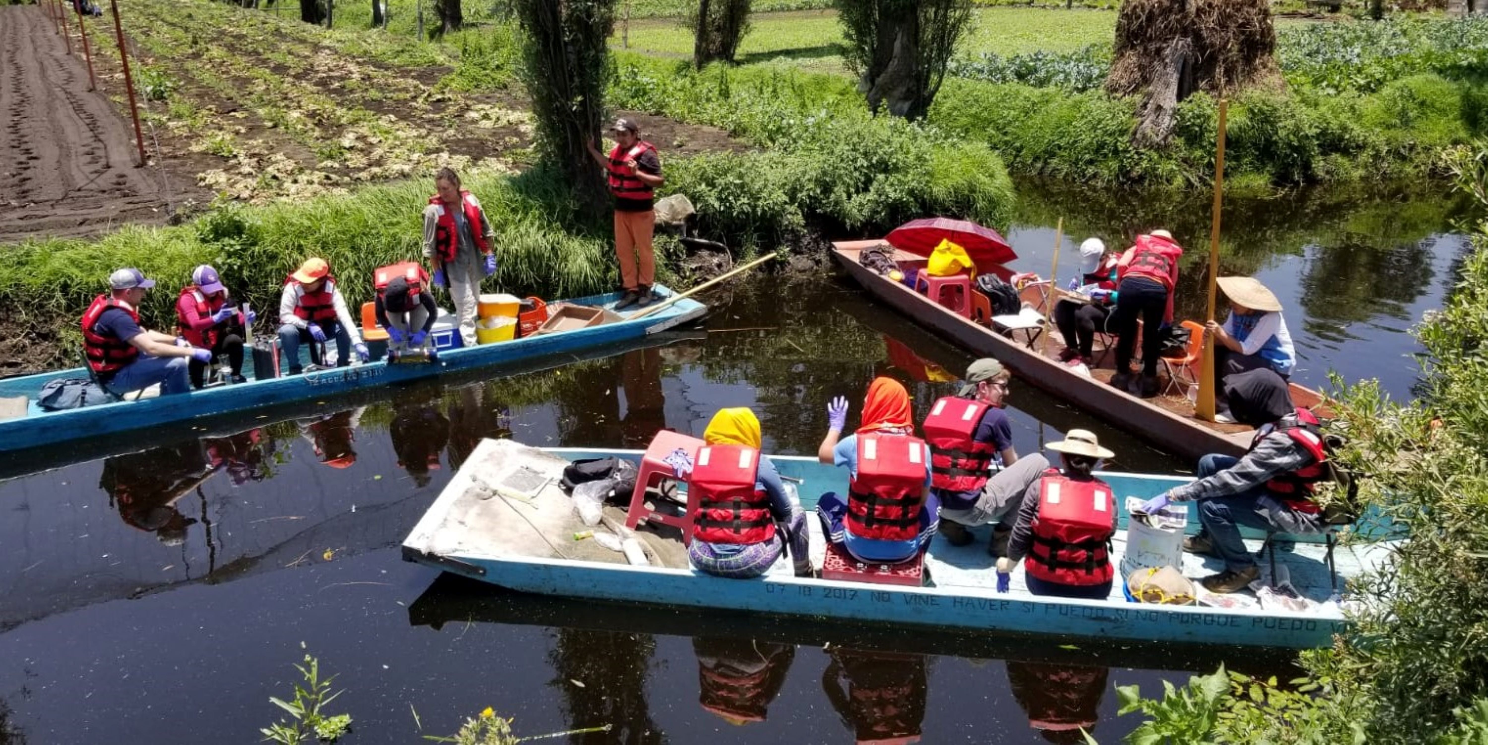 EY volunteers floating in a waterway