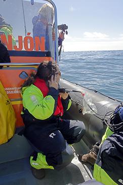Earthwatch volunteers listen for killer whale calls