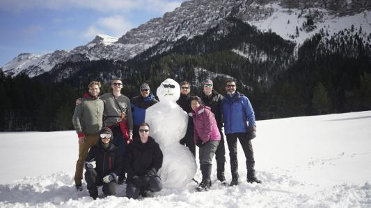 earthwatch volunteers pose with a snowman in the pyrenees