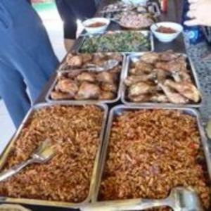 A buffet style meal featuring meat, vegetables and rice (C) Earthwatch Australia