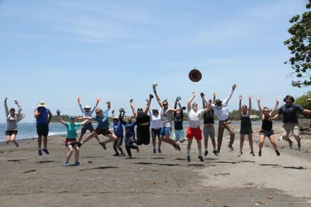 Earthwatch volunteers pose for a funny photo on the beach (C) Earthwatch Australia