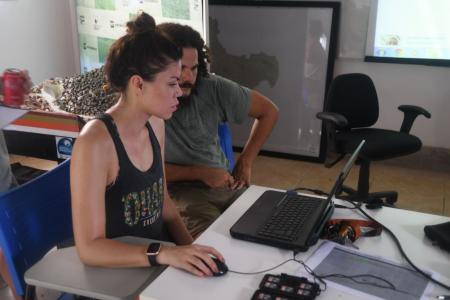 Earthwatch volunteers help analyze data in the lab