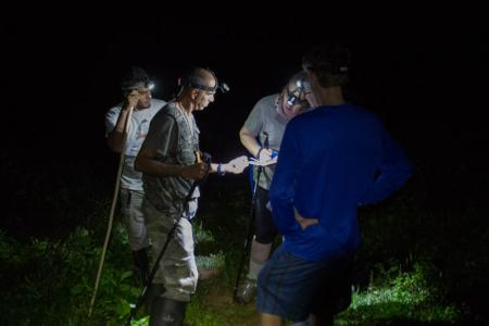 earthwatch volunteers with headlamps at night