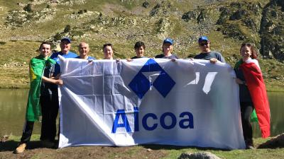 Alcoa employees holding an Alcoa flag