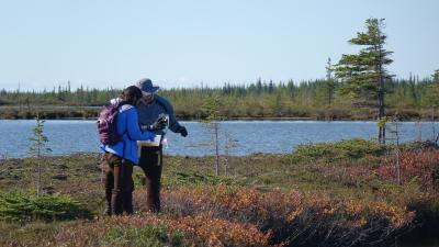 Two Earthwatch volunteers doing fieldwork