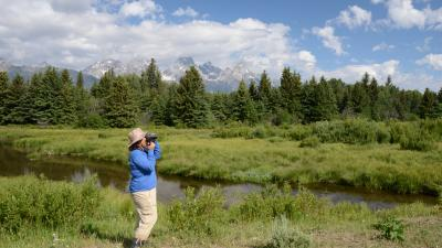 Judith observing wildlife in Wyoming