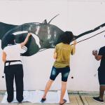 Earthwatch volunteers paint a giant manta ray mural