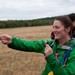 Earthwatch volunteer assisting scientists conduct field research